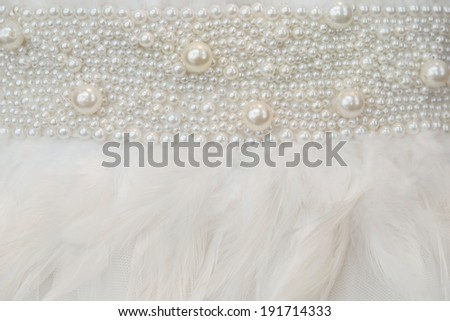 part of wedding dress with decoration of pearls and features - stock photo