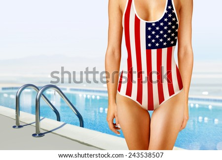 part of woman in swimwear as the American flag near swimming pool - stock photo