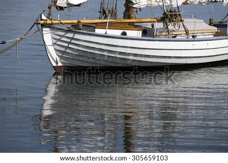 Part of wooden sailboat in a Danish harbor - stock photo