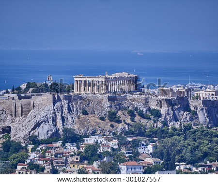 Parthenon ancient Greek temple on acropolis hill and Plaka old neighborhood - stock photo