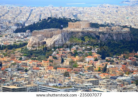 Parthenon temple on the Acropolis hill and the street labyrinth of the Greek capital, Athens, Greece - stock photo