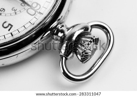 Partial detailed look at an old stopwatch in black and white - stock photo