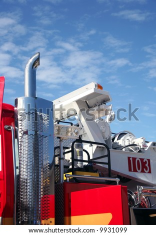 Partial fire engine with beautiful blue cloudy sky - stock photo
