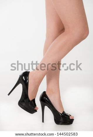 Partial of legs and high heels - stock photo