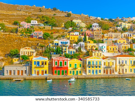 partial view of the pictorial old main port of Symi island in Greece - stock photo