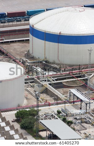 Partial view of two chemical tanks at a petrochemical storage plant. - stock photo