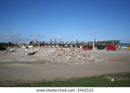 partially demolished derelict factory in industrial area - stock photo