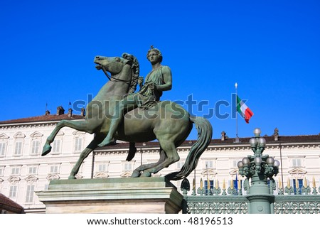 Particular of  Horse Equestrial statue with Palazzo Reale in background - stock photo