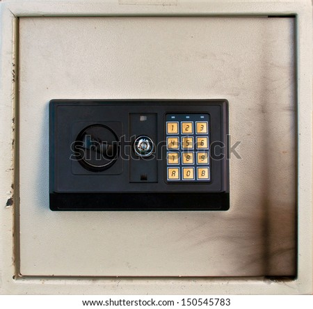 Partly burned private small safe with key panel - stock photo