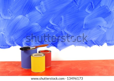 Partly finished blank blue painted wall with paint cans and paintbrushes.  Space for copy. - stock photo