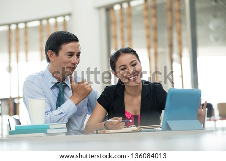 Partners being happy about the results of their successful project - stock photo