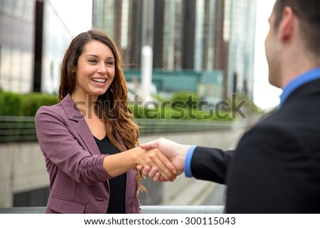 Partners finance success sales person shaking hands greeting meeting first time - stock photo