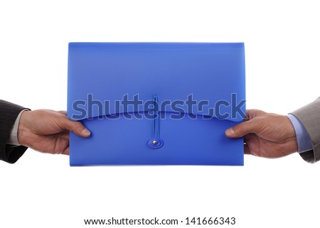 Partnership or teamwork concept two men handing over a document file - stock photo