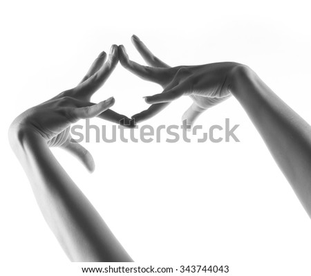 Parts of body.  Ballet dancer hands over white - stock photo