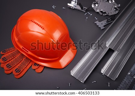 Parts of the building structures and protective clothing - stock photo