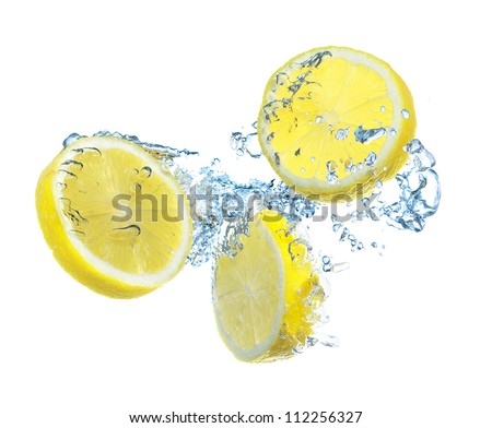Parts of the lemon and water splash. Healthy and tasty food - stock photo