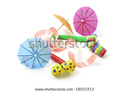 Party Blowers and Cocktail Umbrellas on White Background - stock photo