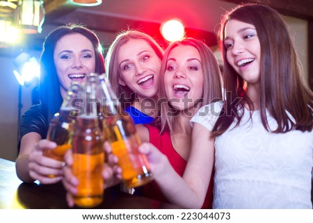 Party, celebration, friends, bachelorette and birthday concept - three beautiful woman in evening dresses with cocktails - stock photo