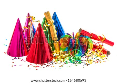 party decoration. colorful garlands, streamer, hats and confetti on white background - stock photo