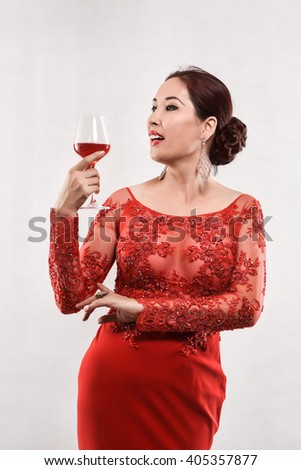party, drinks, holidays, Christmas and people concept - isolate Sexy smiling Asian Chinese Japanese Korean woman in Red evening dress with glass of Red wine over white background - stock photo