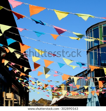 Party flags against blue sky - stock photo