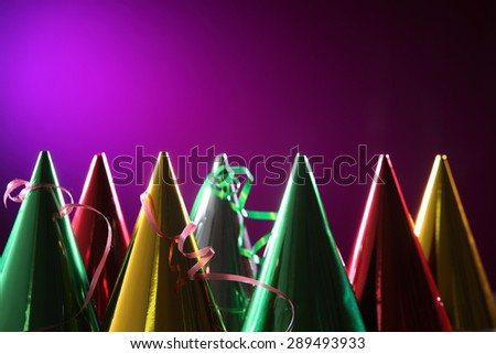 party hat on the purple background - stock photo
