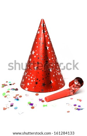 Party hat, whistle and confetti for a celebration, isolated on white background.  - stock photo