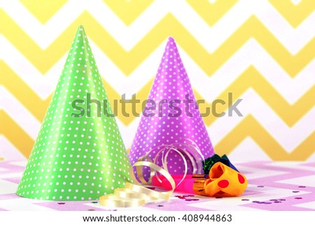 Party hats on a zigzag pattern background - stock photo