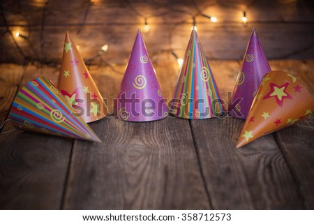party hats on old wooden  background - stock photo
