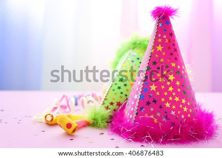 Party hats on pink table - stock photo