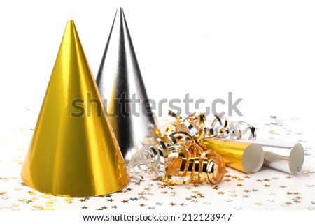 Party hats,paper streamer and confetti on white background - stock photo