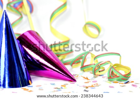 Party hats with paper streamer - stock photo