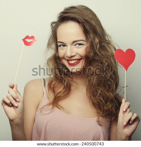 Party image. Playful young women holding a party heart. - stock photo