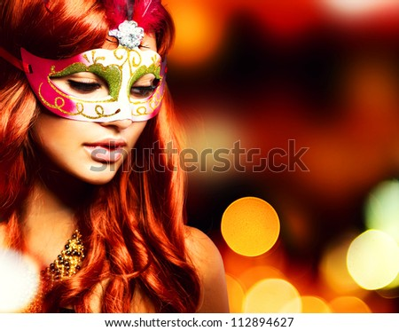 Party.Masquerade. Beautiful Girl in a Carnival mask over Holiday Blinking Background. - stock photo
