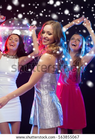 party, new year, celebration, friends, bachelorette party, birthday concept - three beautiful women in evening dresses dancing in the club - stock photo