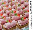 Party nibble of ham and feta cheese on a cocktail stick - stock photo