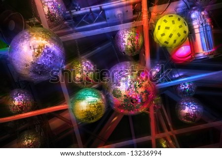 party. nightlife. mirrorballs in  discotheque with lighting effects - stock photo