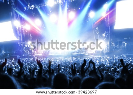 Party people at a frenetic pop concert - landscape exterior - stock photo