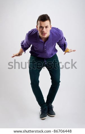 party starter inviting you, against studio background - stock photo