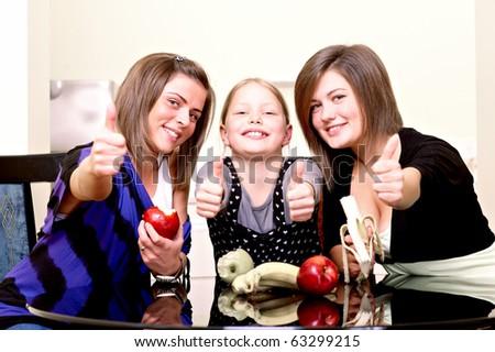 Party. Three cheerful girls. - stock photo
