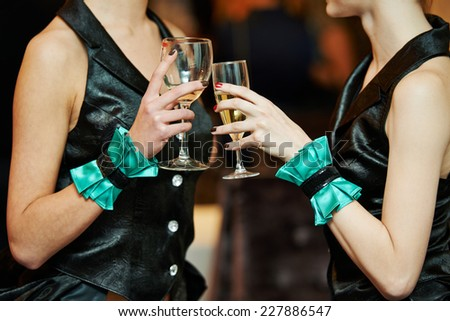 Party time, two female woman guest hands and glass with wine - stock photo