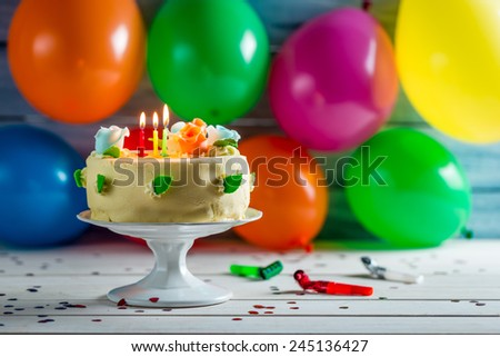 Party with balloons and a birthday cake - stock photo