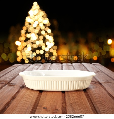 party with plate and xmas tree  - stock photo