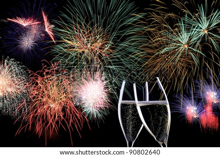 Partytime with  Fireworks and two glasses of Champaign - stock photo