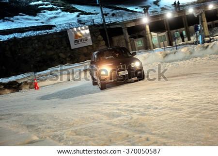 PAS DE LA CASA, ANDORRA - DEC 19: Spanish driver Carles Sanvicens and his codriver Carlos Saspulgas in a BMW 325iX E30 race in the Andorra Winter Rally 2015, on Dec 19, 2015 in Pas de la Casa, Andorra - stock photo