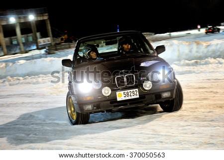 PAS DE LA CASA, ANDORRA - DEC 19 : Spanish driver Vicent Folguera and his codriver Iolanda Gelabert in a BMW 325iX E30 race in the Andorra Winter Rally 2015, on Dec 19, 2015 in Pas de la Casa, Andorra - stock photo