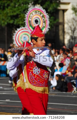 PASADENA, CA - JANUARY 1: The Musical Delfines Xalapa Veracruz Mexico marching band plays at the 122nd tournament of roses Rose Parade on January 1, 2011 in Pasadena California - stock photo