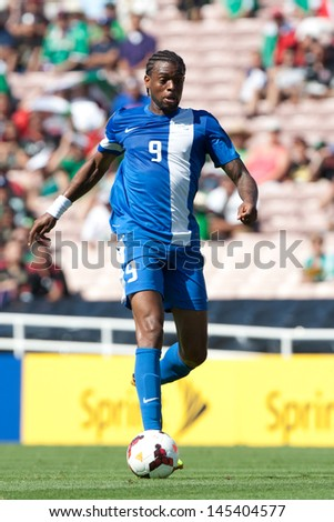 PASADENA, CA - JULY 7: Frederic Piquionne #9 during the 2013 CONCACAF Gold Cup game between Canada and Martinique on July 7, 2013 at the Rose Bowl in Pasadena, Ca. - stock photo