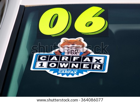 PASADENA, CA/USA - JANUARY 16, 2016: CARFAX decal on used automobile for sale. Carfax, Inc. is a service that supplies vehicle history reports. - stock photo