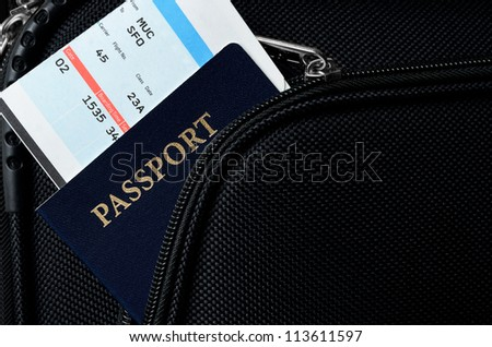 pasport and bording pass in a suitcase - stock photo